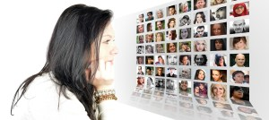 a woman looking at a photo montage of different people's faces demonstrating different points of view or the reality more than just one right and one wrong