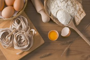 eggs, flour, spoon, rolling pin - all that is needed to make fettuccini noodles