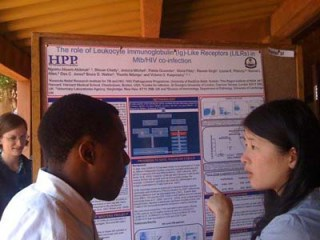 Students Discuss research during the poster session.