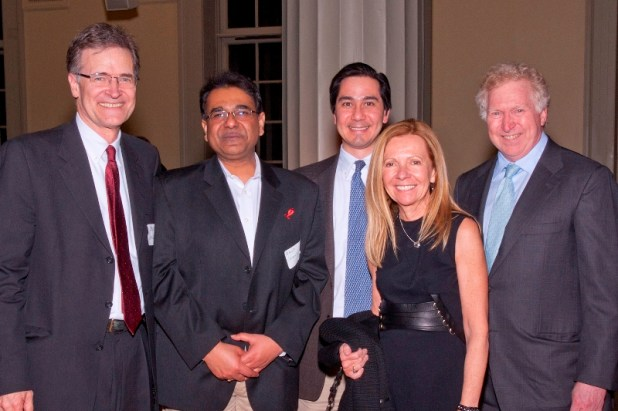 Drs Walker, Chakraborty and Barouch with Terry and Susan Ragon