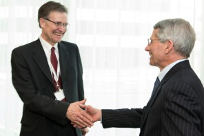 Dr. Bruce Walker greets Dr. Anthony Fauci during the dedication