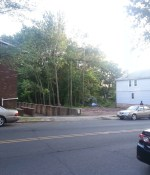 The three properties to be acquired are to the right of the vacant lot.