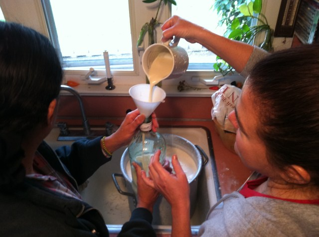 Making coquito, a traditional Puerto Rican holiday egg nog type drink made with coconut.