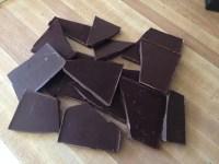 Dark chocolate bars broken up for melting.