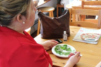 Workshop participant Alma enjoying a sample of the arugula salad.