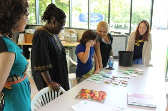 Workshop participants picking out seeds to take home with them to grow, save and share.