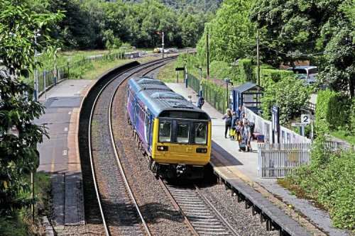 Its days now numbered, Northern 'Pacer' No. 142043 arrives at Grindleford with the 10.49 Manchester Piccadilly to Sheffield on July 30. Graham Nuttall