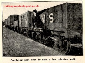 Image of railway worker precariously riding on a wagon