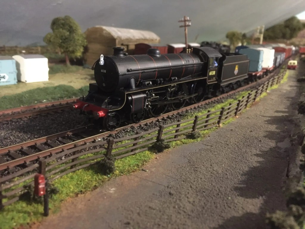 00 gauge model railway layout with steam locomotive