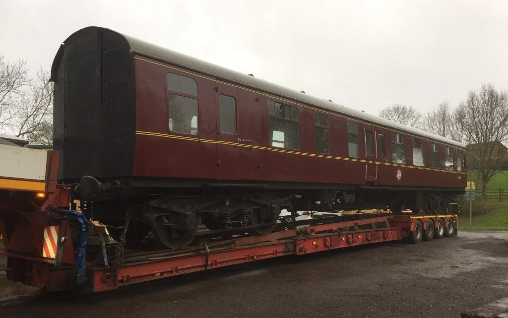 BR Mark1 carriage on low loader at the S&D railway