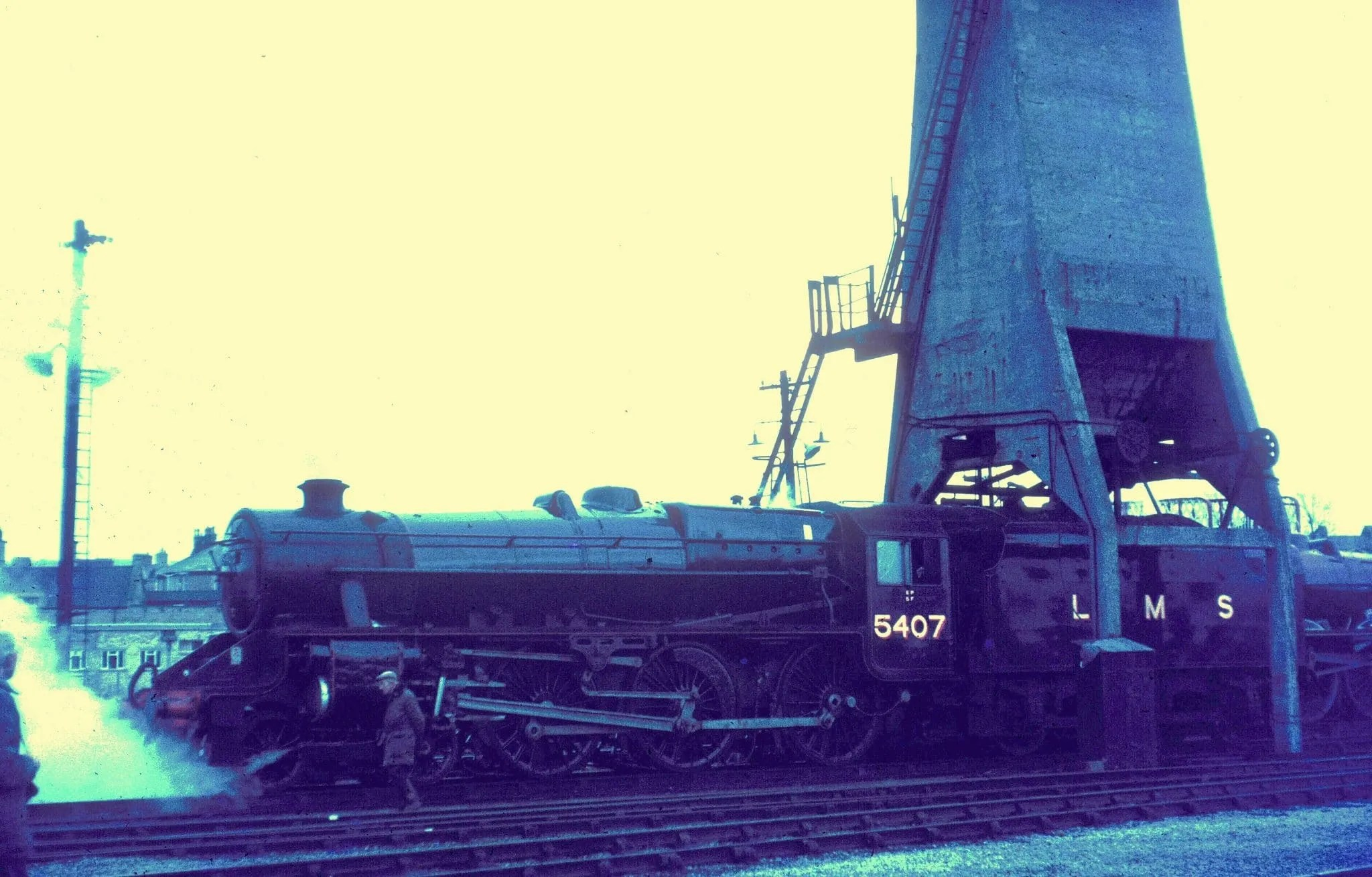 Steam locomotive Stanier Black Five 5407 with coaling tower at Carnforth