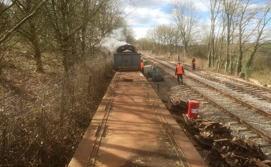 Jinty 47406 moving track materials for relaying track at the Somerset and Dorset Railway