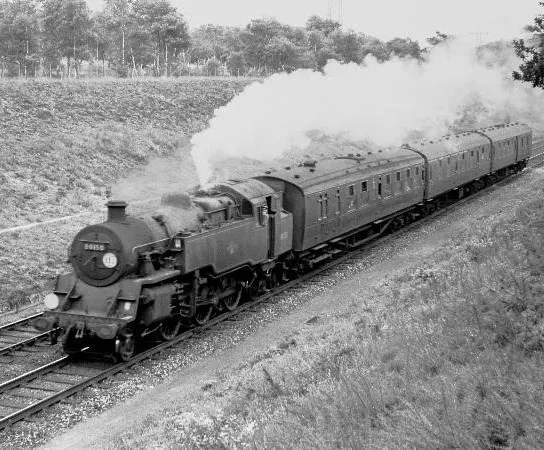 steam locomotive 80150 steaming through HintonAdmiral