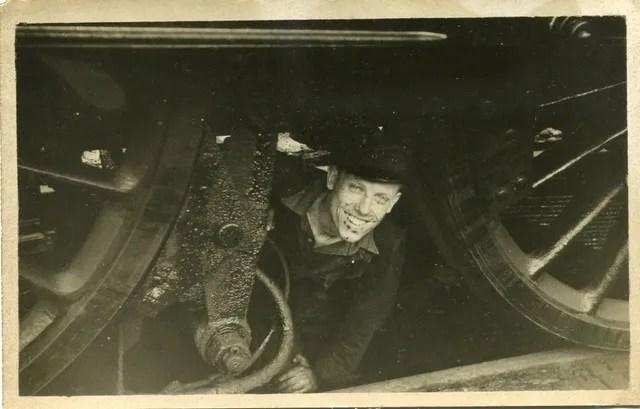railway memories book showing author under a steam locomotive at Crewe Works