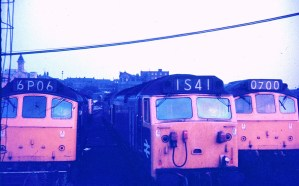 Class 50 diesel locomotive sandwiched between two Class 25 diesel locomotives at Preston