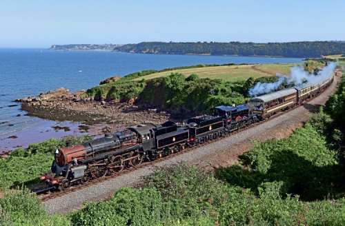 BR comeback 3: Patch-painted '4MT' 4-6-0 No. 75014 pilots No. 7827 Lydham Manor past Waterside, with the 15.40 Kingswear-Paignton service on August 23. ROBERT SHERWOOD