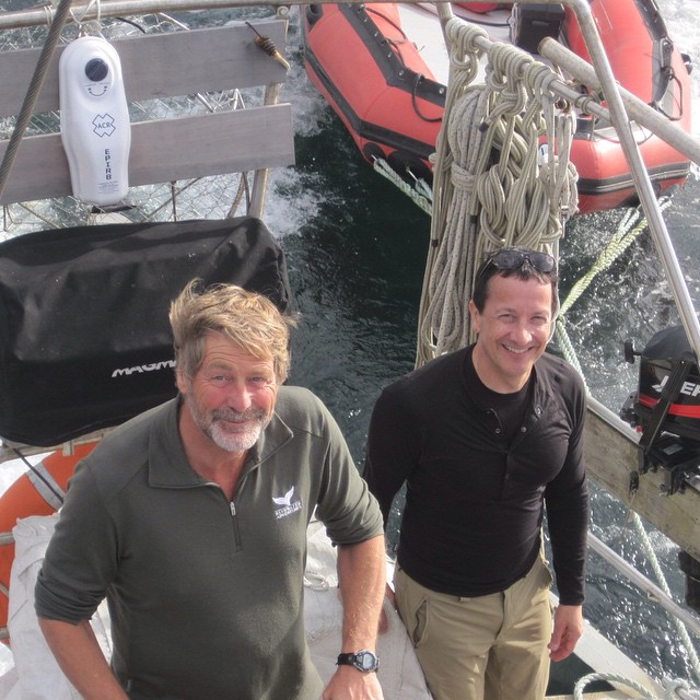 Two men from Raincoast Conservation Foundation pose on the boat Achiever