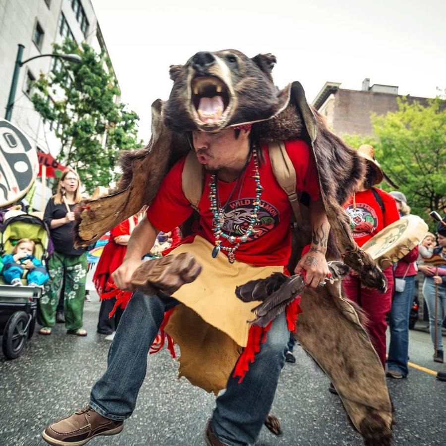 Wild Salmon Caravan, a celebration of the spirit of wild salmon through arts and culture, held yearly, featured Coast Salish and this photograph was taken by Micahel O Snyder during the fesival of a Coast Salish member dancing
