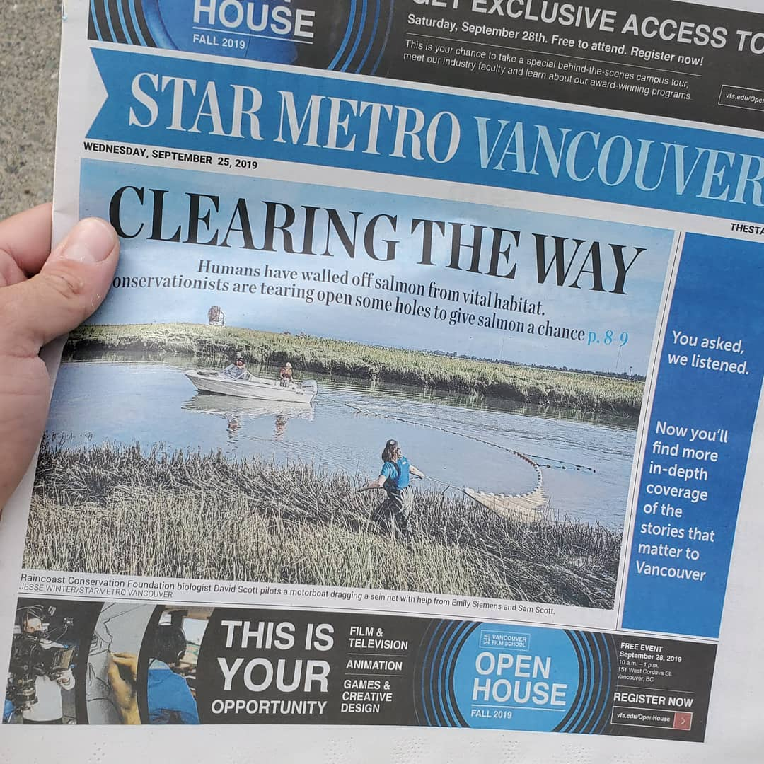 Thumb visible of hand holding up the newspaper Star Metro Vancouver with the headline Clearing the Way