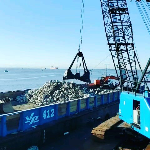 Crane lifts a load at the Steveston Jetty breach reconstruction
