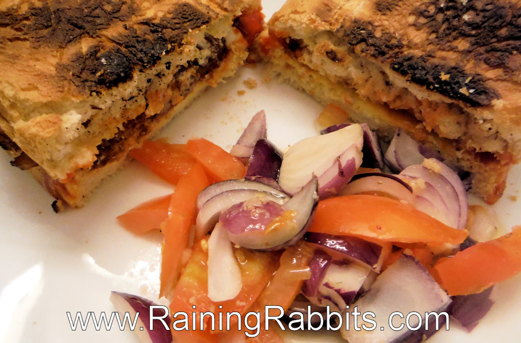 vegan sausage sandwich with red onion and tomatoes