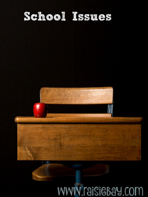 school desk with apple