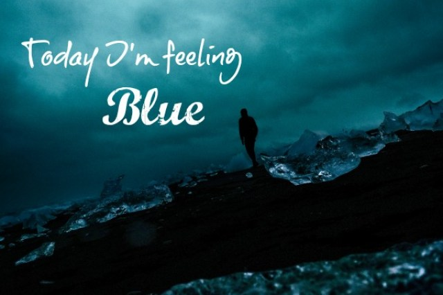 Dark blue image of man and the sea and the text, Today I'm feeling Blue