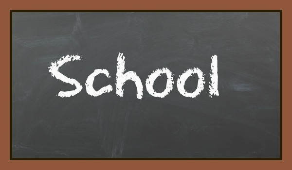 black board with the word school written in chalk