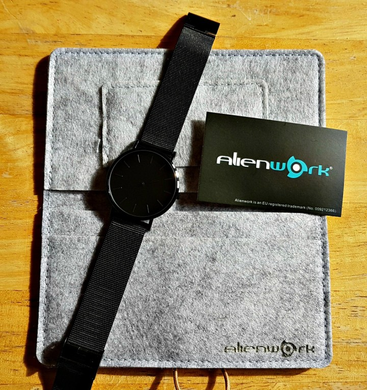 black watch with label and grey pouch
