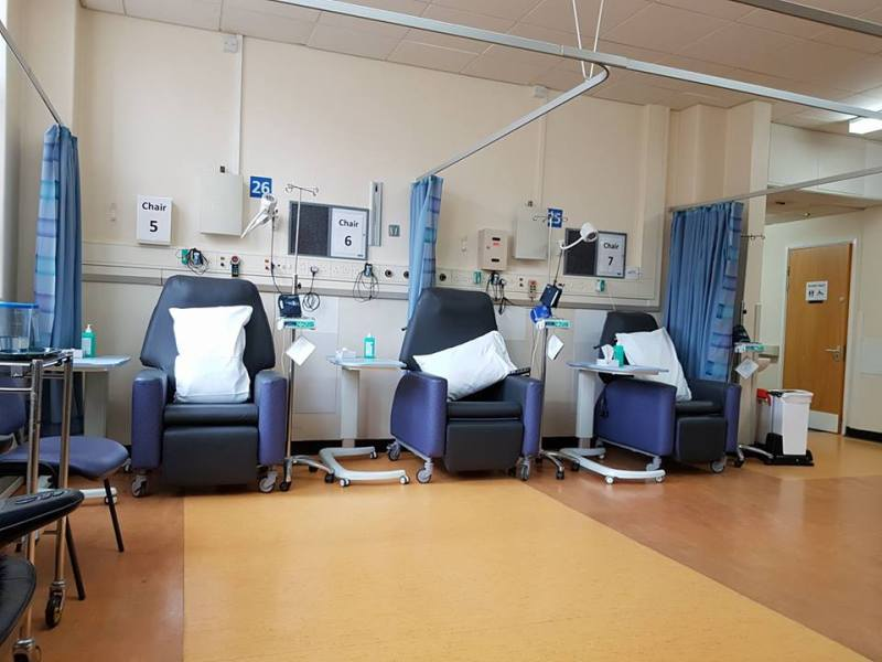 a hospital day ward with empty chairs