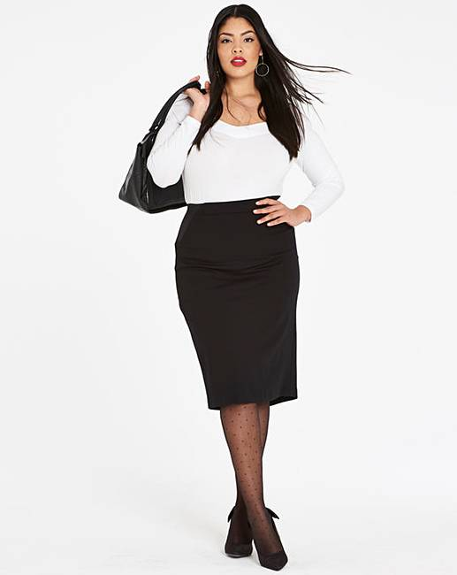 model wearing a white long sleeved top and a black midi pencil skirt