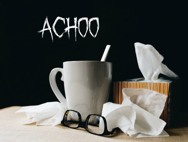 a box of tissues, a mug and glasses and the word 'achoo'