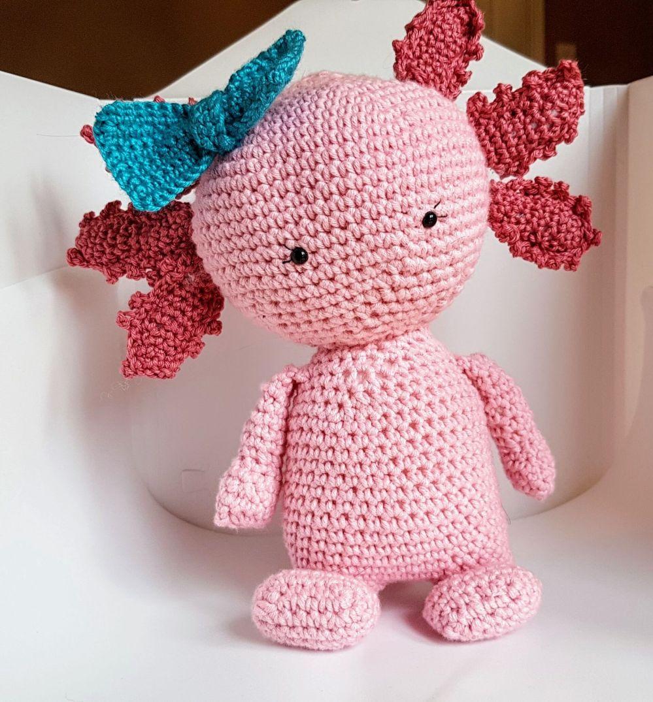 a pink crochet axolotl