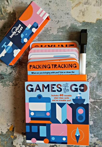 Games on the Go, a colourful box with the lid open showing several playing cards and a wipe clean pen