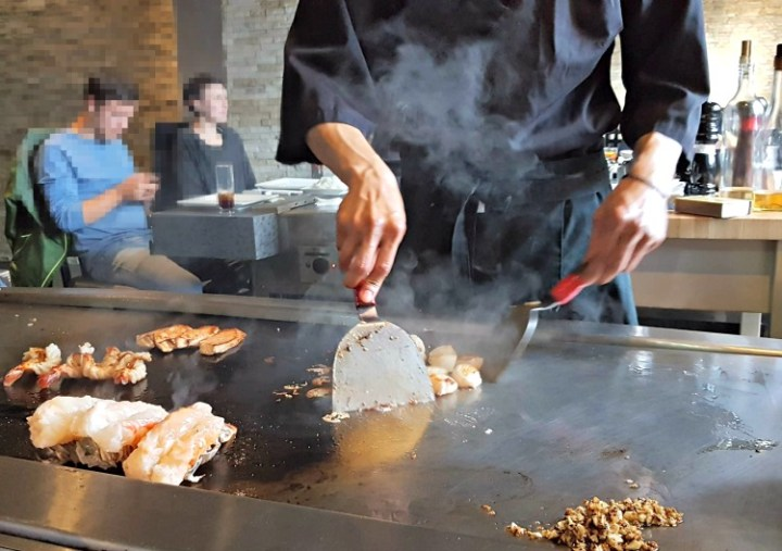 Chef cooking on the teppan grill