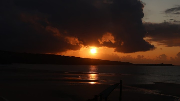An orange glowing sunset over the sea