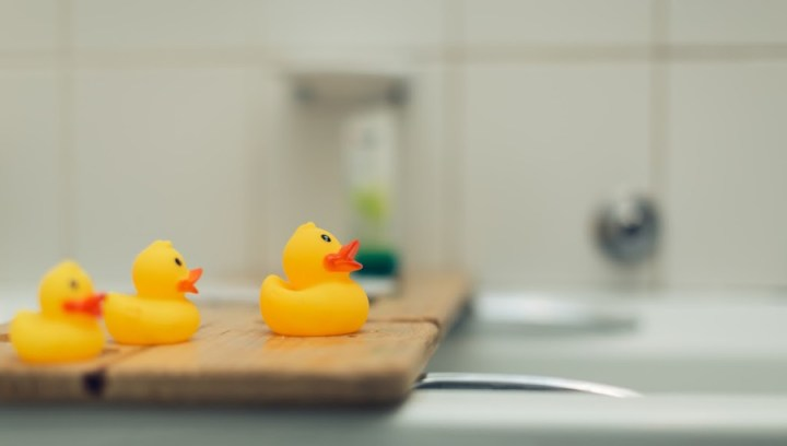 bathroom blurred with bath ducks in front