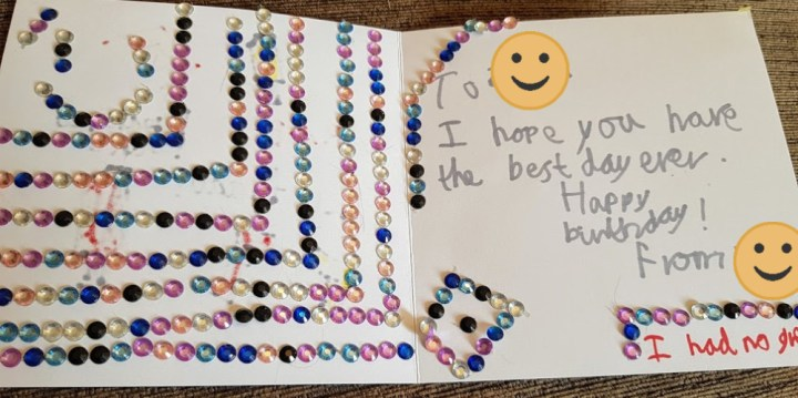 Inside the birthday card filled with tons of little shiny jewels