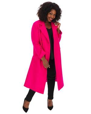 A model wearing a really bright fuschia oversized coat