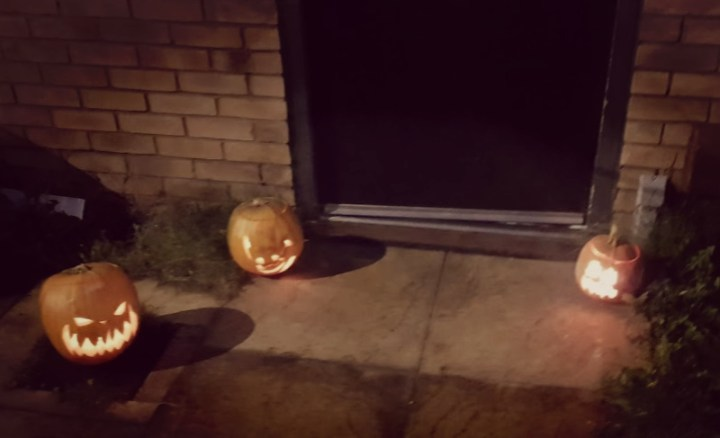The pumpkins outside lighting tthe door step