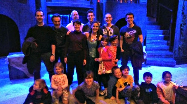 The kids on stage with the Treasure Island cast, The case are standing at the back with the children sitting at the front. Apart from Boo who is cuddling her favourite character, the mermaid.
