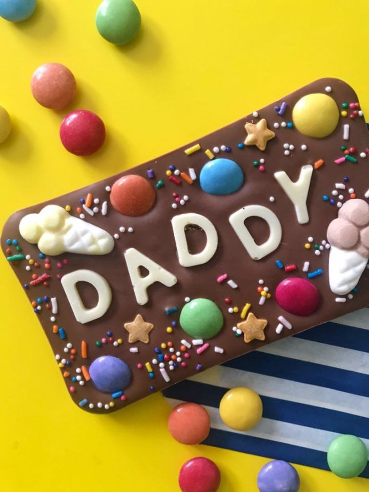 chocolate bar with sweets and word Daddy on it.