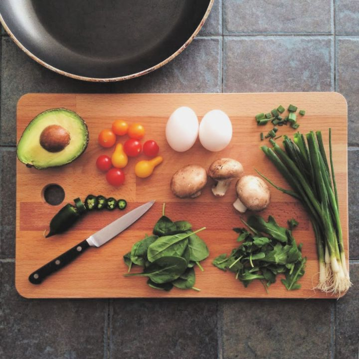 stay healthy with fresh food, a chopping board of fresh vegetables ready to cook.