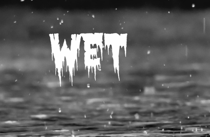 Image shows rain dripping onto a pavement and the word wet in white dripping letters