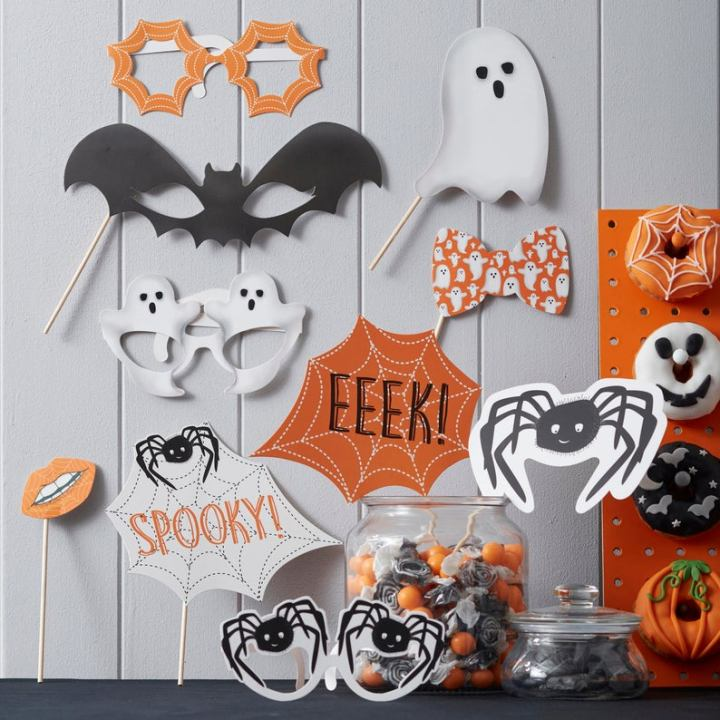 photo booth props, spiders, webs, pumpkins,