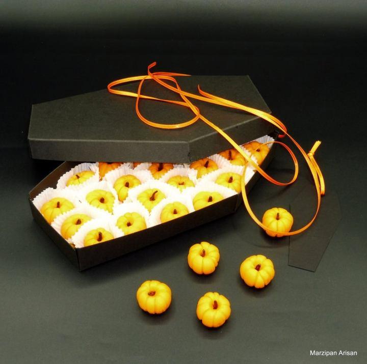 marzipan pumpkins in a cardboard coffin