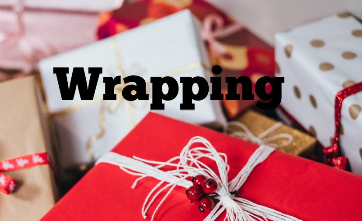 wrapping, word surrounded by Christmas presents all neatly wrapped