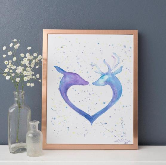 print of a deer and stag head in a heart shape in blue