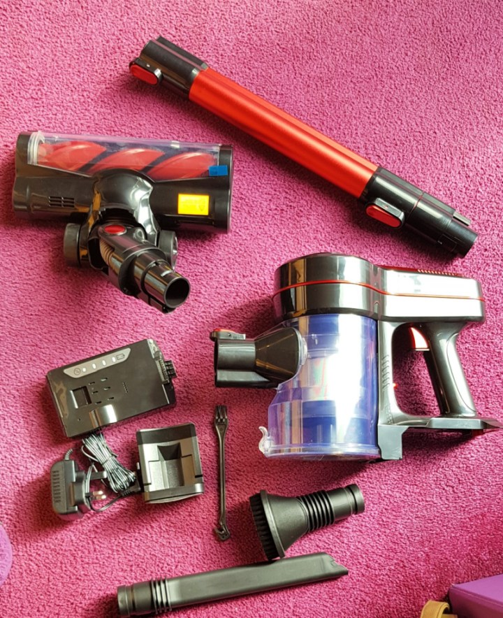 contents of the Moosoo Vaccum box arranged on the floor.