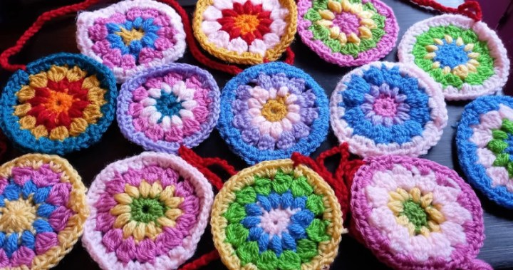 a garland of colourful crochet flowers